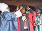 Governor Akpabio being decorated by the Chancellor of Enugu State University Science and Technology