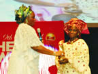 Wife of the Akwa Ibom State Governor, Unoma Akpabio presenting Nigerian Hero Award to Mrs. Elizabeth Akande